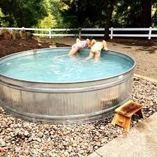 Stock Tank Pool Ideas For Your Incredible Summer [MUST-LOOK] - Get your stock tank pool DIY ideas right here! Find from galvanized, plastic, poly or metal stock tank pool inspirations. Diy Pool, Above Ground Swimming Pools, Swimming Pools Backyard, Swimming Pool Designs, In Ground Pools, Kiddie Pool, Backyard Landscaping, Pool For Small Backyard, Cheap Above Ground Pool