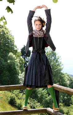 Great style, black Dirndl, scarf, Trachtenjacke and matching apron with super cool green socks and totally unprotect shoes. Super cute.
