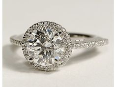 1920s vintage engagement ring. I am obsessed with the thin diamond band and circling the center stone.