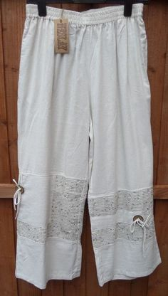"Quirky Lagenlook wide leg trousers, 60% linen, 40% viscose. size 3/4 which fits size 16/18 flattering with elasticated waistline, waist unstretched measures approx. 30"", but can stretch to approx. 48"" ! 
