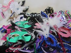 140 masquerade favors DONE!!!; design by Davis Floral Creations