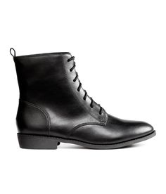 bde19cfdf6a9 Check this out! Ankle boots in imitation leather with a loop at back and  lacing
