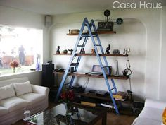 Ladder shelf - great idea if you don't want to drill holes in rented walls!: 25 Awesome DIY Ideas For Bookshelves