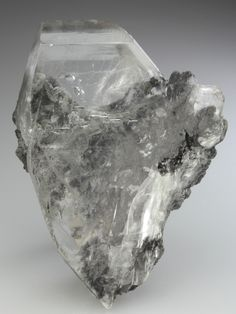 Gypsum, Tsumeb Mine, Namibia. Crystal, gemmy with lustrous faces, with moving bubble trapped in an internal cavity. Size Gypsum crystal 9cm. A matrix dominated by metallic grey Galena, with some micro-crystals of Calcite. The bubble can clearly be seen moving in its cavity down from the termination and just off centre, measuring to 0.5cm. Gypsum Crystal, Gypse, Gemstone Jewelry, Bubbles, Gemstones, Crystals, Centre, Metallic, Faces
