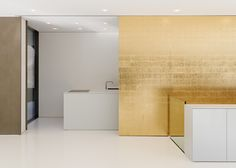 Gold leaf wallpapered walls in a very modern house // dezeen.com // Haus D10 by Werner Sobek