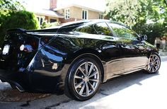 """Black Nissan Altima Coupe 3.5 that I purchased during my """"midlife crisis"""" last year but it was fun to zip around in..."""