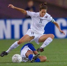 Julie Foudy leaps over Maria De Souza Diaz of Brazil on June 27, 2000, at a match in Foxboro, Mass. (Steven Senne/AP)