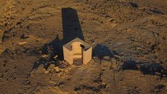 Gitai Architects used rammed earth and stones from the nearby Mitzpe Ramon crater to build the Landroom observatory in Israel's Negev desert. Mitzpe Ramon, Journal Du Design, Up To The Sky, Rammed Earth, Great Wall Of China, Spiral Staircase, Dutch Artists, School Architecture, Landscape Architecture