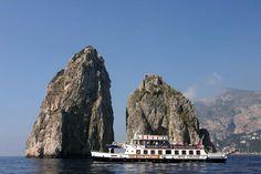 Ferry sailing past I Faraglioni, Island of Capri.