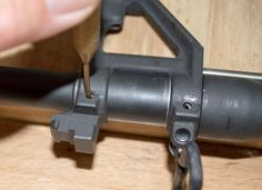 How To Install An AR-15 Free-floated Hand Guard, Remove the front sight