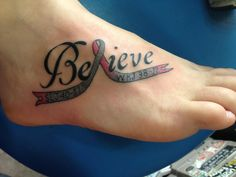 My tattoo!! Gray is for lung cancer I lost my grandma to.. Pink is for Breast Cancer! Also has my Grandma and Grandpas initials <3