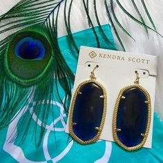 "NWT Kendra Scott Danielle Navy Cat's Eye Earrings! NWT Kendra Scott Danielle Navy Cat's Eye Earrings! Comes with Kendra Scott jewelry dust pouch. ""Go from street chic to evening elegance in these classic statement earrings! Our Danielle earrings in navy cat's eye are a stunning go-to for a subtle touch of color.""  DETAILS •	14K Gold Plated Over Brass •	Size: 1.89""L X 1""W on earwire •	Material: navy blue cat's eye Kendra Scott Jewelry Earrings"