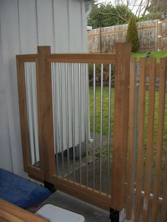 """https://flic.kr/p/4jri82   Modernish Fence Detail   Here's more of a closeup of the fence.  It is made up of pressure treated lumber (4x4 posts, 2x4's and 2x2's) and 1/2"""" conduit bars."""