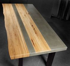 """Concrete Wood & Steel Dining Kitchen Table $4,500 - $5,500 Made by Jason Sitter OF TAO CONCRETE TEMPE, AZ. Dining room table measuring 90"""" in length x 42"""" wide x 30"""" tall was created using natural grey concrete contrasted with a center wood inlay and natural wood edge made from hickory. The top is supported by a welded steel frame, sandblasted and finished with a matte black powder coat."""