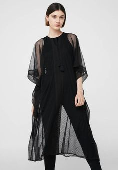 Mango. Tunic - black. Fit:oversized. Outer fabric material:100% polyester. Pattern:polka dot. Care instructions:do not tumble dry,machine wash at 30°C. Details:tassels. Neckline:round neck. Length:extra long. Sleeve len...