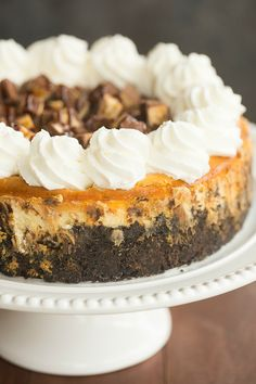 "Snickers Cheesecake | browneyedbaker.com #recipe  Great. Too much batter for 9"" pan."