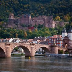 Heidelberg, Germany, is an absolutely gorgeous city, and there's even a castle to explore. There's a canal running through the city, which is surrounded by hills. You'll fall in love with it!