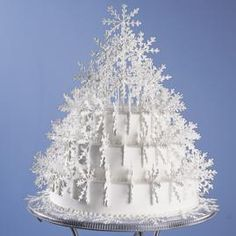 A sculpture of dainty royal icing snowflakes adorns this stunning cake creation. This cake makes a fabulous centerpiece for any winter celebration! Snowflake Cake, Snowflakes, Snowflake Pattern, Noel Christmas, Christmas Baking, Cupcakes, Cupcake Cakes, Cake Icing, Eat Cake