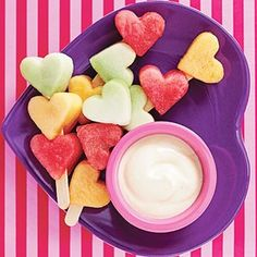 Heart fruit kabobs with yogurt dip - here's a good idea to get someone to eat their fruit, use small cookie cutter in all different shapes.....