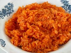 mexican red rice.... pretty easy & good! Used all the juice and 3/4 of the tomatoes of a 15 oz can of diced tomatoes instead of the two tomatoes and sauce - worked great! Also, used potato masher to crush tomatoes once in pan.