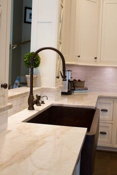 Loving the copper apron front sink and Waterstone faucet combination