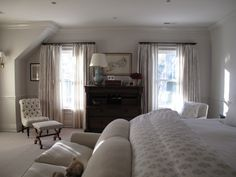 Jane Green - bedrooms - two-tone, greige, walls, chair rail, greige, sheers, drapes, chest, dresser, ivory, tufted, slipper, chair, linen, sofa, paisley, bedding, blue, double, gourd, lamp, bedroom sofa, bedroom couch, sofas for bedrooms, couches for bedrooms,