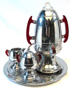 United Art Deco Coffee Maker Percolator Set. I have this coffee pot, but not the rest. Love the red handles. #coffeeart