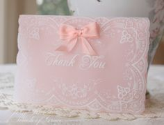 Made of parchment paper using parchment techniques with Pergamano tools and lined with pastel embossing paper and matching taffeta bows on the card fronts. I love the soft, delicate appearance of the parchment paper, it's so beautiful!