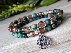 Blue Yoga Bracelet with Om Symbol #yogabracelets #omjewelry