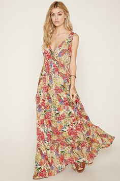 A sleeveless woven maxi dress by Raga™ with a V-neckline, a V-back, an elasticized waist, a tiered skirt, and an allover detailed print of flowers and different birds.