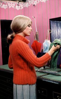 """Catherine Deneuve selling umbrellas in """"Les Parapluies de Cherbourg,"""" 1963"""