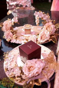 Set your engagement ring boxes on a pretty mother of peal platter with floral…