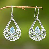 Love these... 'Denpasar Light' blue topaz floral earrings from Bali. Novica.