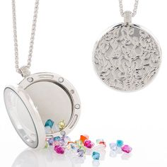 "Kaleidoscope Locket - Reversible - Colors swirl in this charming locket!  Colorful crystal beads, flowers and a butterfly, create playful patterns. Locket reverses to reveal etched floral design.  Rhodium plating; 24"" to 27"".   Note: Crystal bead colors may vary."