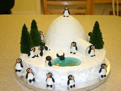 Hands down my favorite cake.  Got the idea on this site (thanks!).  The penguins, fish and igloo tiles are fondant.  Trees are sugar cones.  Water is piping gel with blue food coloring. The igloo is the Wilton barbie doll cake pan (the dress). The cake was very time consuming but did not take much skill at all.