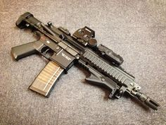 Custom HK416C AEG with: Strike Industries Cobra Tactical Fore Grip Socom Gear Lancer L5 Advanced WarFighter Magazine. ASCU mosfet. Built in lipo 11.1v battery Moe grip