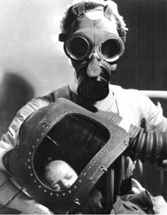 Mother and child in gas masks