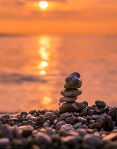 Stacked stones are enjoying the sunset - null