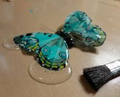 resin onto a feather butterfly