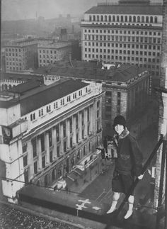 Margaret Bourke White - She was a daredevil who would rest her camera on steel gargoyles on the top of building to get the photo