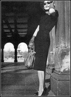 Sophia's Vintage Fashion Pic(k)s: Model in short-sleeved, collarless black jersey tu...