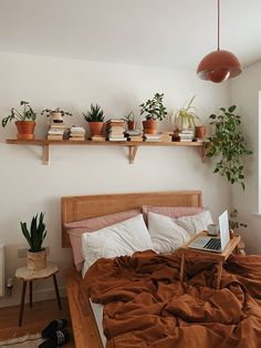 Neutral bohemian bedroom with ochre accents, plants and books. Mental wellbeing in the home. Mental wellbeing, my home and me – Noor Hasan Room Ideas Bedroom, Home Bedroom, Master Bedroom, Nature Bedroom, Bedroom Inspo, Bedroom Inspiration, Lighting Ideas Bedroom, Nature Inspired Bedroom, Shelf Inspiration