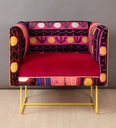 A unique handmade armchair upholstered with colorful vintage Suzani, Thai Hmong and fuchsia color velvet fabrics. The design is completed with