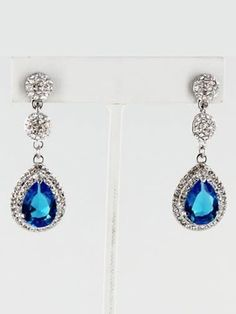 Imagine how wonderful your wedding will be with these elegant blue pendant earrings decorating your ears! You have something blue covered, but what will you do for something old and something new? $30.00