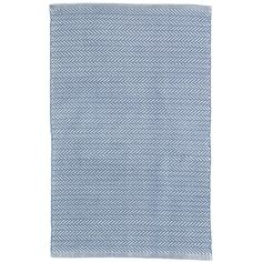 Test drive this rug in your space.Order a swatch by adding it to your cart.In a timeless denim blue and ivory combo, this herringbone indoor/outdoor rug is the perfect fit for relaxed spaces like the living room, guest bedroom, or kids playroom.