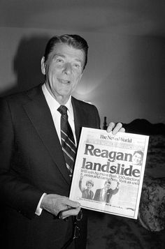 Ronald Reagan beat President Jimmy Carter handily on November 4. Reagan is shown holding a November 4th copy of The News World, predicting his landslide over Carter for the President of the United States.