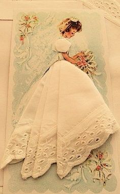 Make a one of a kind bridal shower card with one of Grandma's vintage hankie. Cut a slit at the waist of the illustration, fold to create the skirt then tuck in.