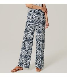 """A regal floral perfectly compliments the bohemian effect of these sweeping wide-leg pants with a flattering, smooth waist. Your perfect fit if your hips are proportionate to your waist. Zip fly with hook-and-bar closure. Belt loops. Slash pockets. Back welt pockets. 31"""" inseam."""