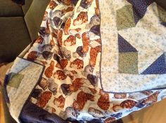 The back of mum's quilt for her bed in the nursing home. I hand quilted it with contrasting navy thread and machine quilted in the ditch around the border.