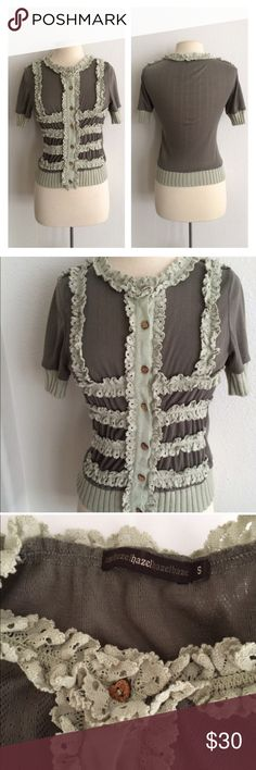 """Hazel ruffle cardigan Hazel ruffle cardigan. Size S. 100% polyester. Extremely stretchy! Heart shaped wooden buttons. Ruffles are gray with a faint hint of green. Measures 21"""" long with a 32"""" bust (stretches easily well beyond that). Calling it good used condition to be safe- there is a little bit of pilling on this.  🚫NO TRADES🚫 💲Reasonable offers accepted💲 💰Great bundle discounts💰 Anthropologie Sweaters Cardigans"""